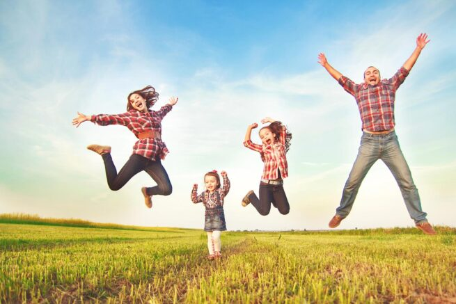 Family-jumping-country-fields